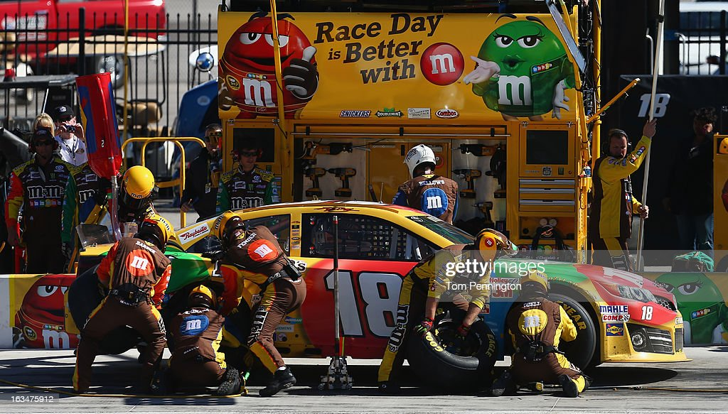 <a gi-track='captionPersonalityLinkClicked' href=/galleries/search?phrase=Kyle+Busch&family=editorial&specificpeople=211123 ng-click='$event.stopPropagation()'>Kyle Busch</a>, driver of the #18 M&M's Toyota, pits during the NASCAR Sprint Cup Series Kobalt Tools 400 at Las Vegas Motor Speedway on March 10, 2013 in Las Vegas, Nevada.