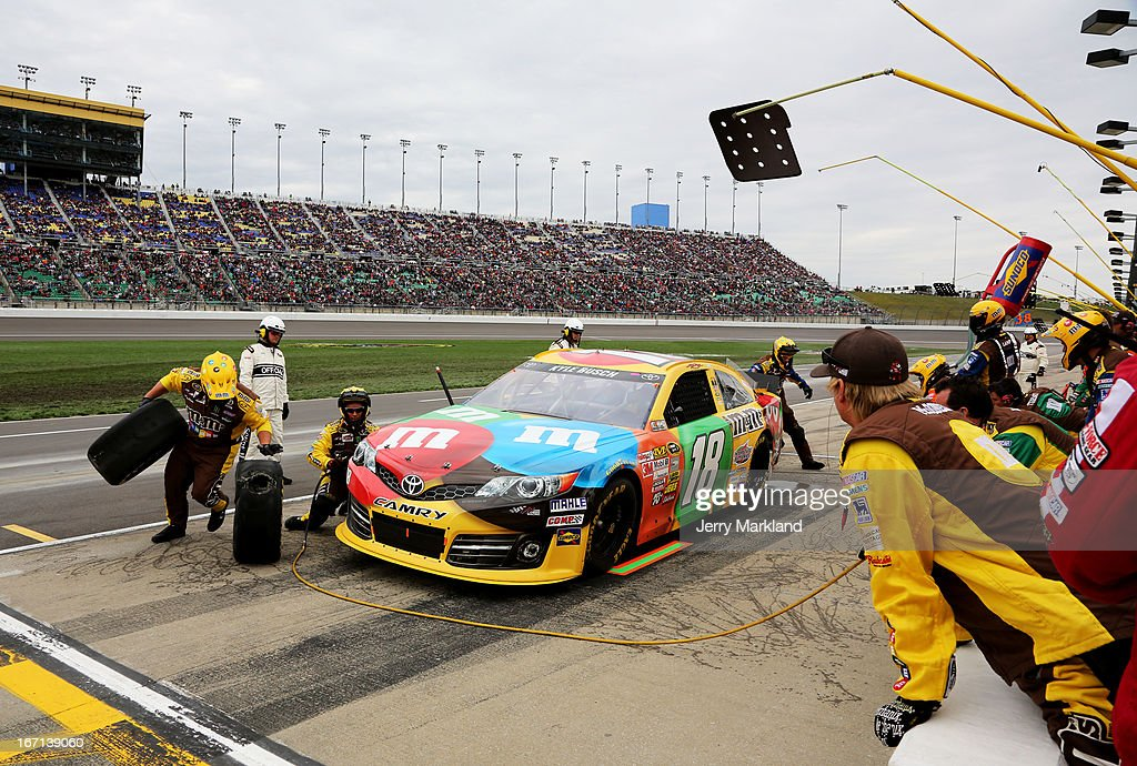 <a gi-track='captionPersonalityLinkClicked' href=/galleries/search?phrase=Kyle+Busch&family=editorial&specificpeople=211123 ng-click='$event.stopPropagation()'>Kyle Busch</a>, driver of the #18 M&M's Toyota, pits with a blown out tire during the NASCAR Sprint Cup Series STP 400 at Kansas Speedway on April 21, 2013 in Kansas City, Kansas.