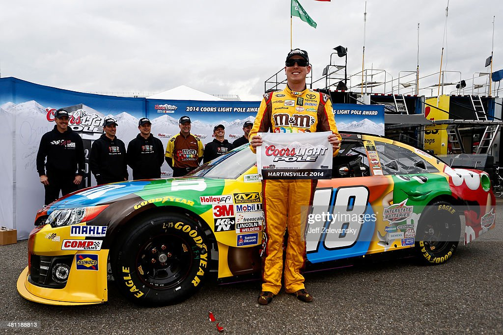 <a gi-track='captionPersonalityLinkClicked' href=/galleries/search?phrase=Kyle+Busch&family=editorial&specificpeople=211123 ng-click='$event.stopPropagation()'>Kyle Busch</a>, driver of the #18 M&M's Toyota, poses with the Coors Light Pole Award after qualifying for the pole during qualifying for the NASCAR Sprint Cup Series STP 500 at Martinsville Speedway on March 28, 2014 in Martinsville, Virginia.