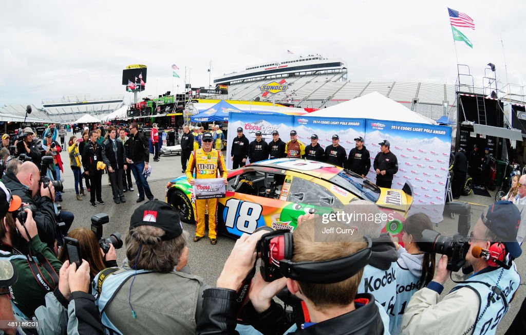 <a gi-track='captionPersonalityLinkClicked' href=/galleries/search?phrase=Kyle+Busch&family=editorial&specificpeople=211123 ng-click='$event.stopPropagation()'>Kyle Busch</a>, driver of the #18 M&M's Toyota, poses with the Coors Light Pole Award after qualifying for the pole for the NASCAR Sprint Cup Series STP 500 at Martinsville Speedway on March 28, 2014 in Martinsville, Virginia.