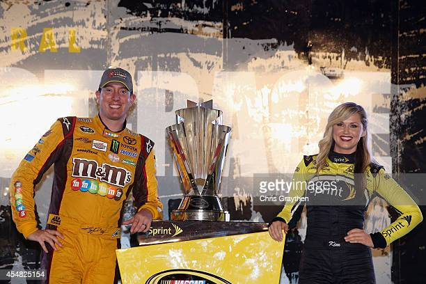 Kyle Busch driver of the MM's Toyota poses with the Sprint Cup Trophy and Miss Sprint Cup Kim Coon after qualifying for the Chase for the Sprint Cup...