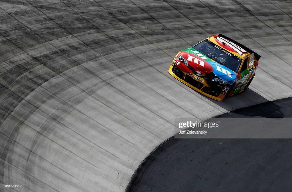 Kyle Busch, driver of the #18 M&M's Toyota, practices for the NASCAR Sprint Cup Series Food City 500 at Bristol Motor Speedway on March 15, 2013 in Bristol, Tennessee.