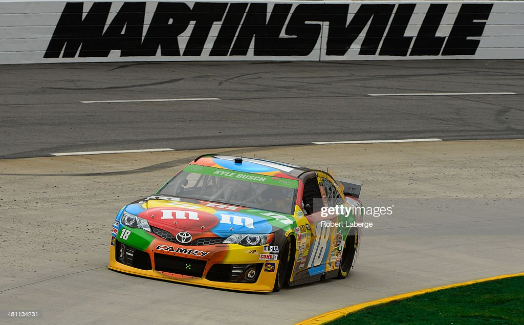 Kyle Busch, driver of the #18 M&M's Toyota, practices for the NASCAR Sprint Cup Series STP 500 at Martinsville Speedway on March 28, 2014 in Martinsville, Virginia.