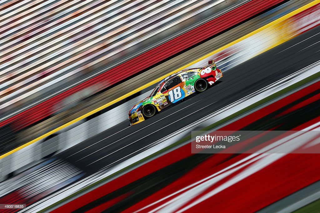 <a gi-track='captionPersonalityLinkClicked' href=/galleries/search?phrase=Kyle+Busch&family=editorial&specificpeople=211123 ng-click='$event.stopPropagation()'>Kyle Busch</a>, driver of the #18 M&M's Toyota, practices for the NASCAR Sprint Cup Series Coca-Cola 600 at Charlotte Motor Speedway on May 24, 2014 in Charlotte, North Carolina.