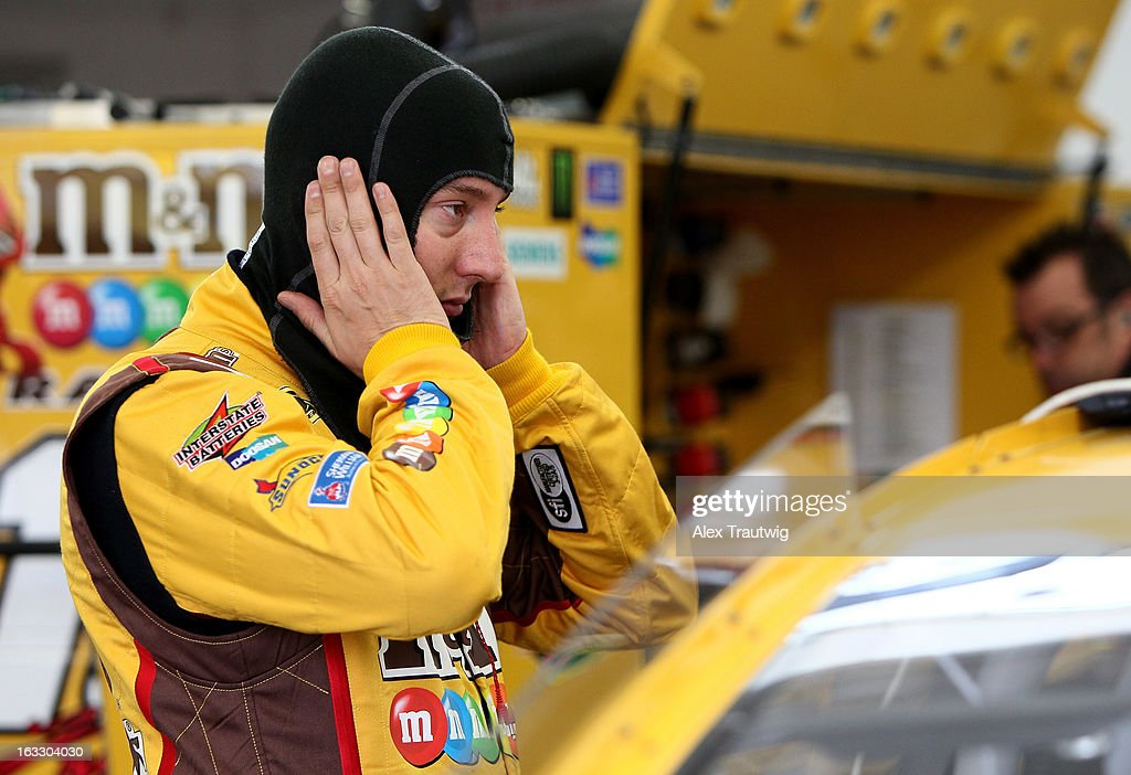 <a gi-track='captionPersonalityLinkClicked' href=/galleries/search?phrase=Kyle+Busch&family=editorial&specificpeople=211123 ng-click='$event.stopPropagation()'>Kyle Busch</a>, driver of the #18 M&M's Toyota, prepares in the garage area during NASCAR Sprint Cup Series testing at Las Vegas Motor Speedway on March 7, 2013 in Las Vegas, Nevada.