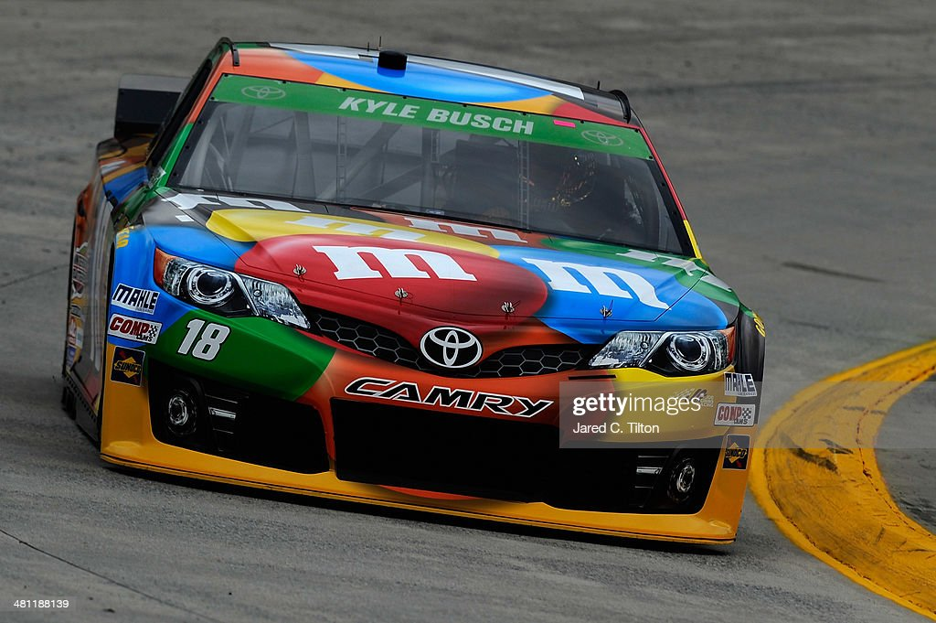 Kyle Busch, driver of the #18 M&M's Toyota, qualifies for the NASCAR Sprint Cup Series STP 500 at Martinsville Speedway on March 28, 2014 in Martinsville, Virginia.