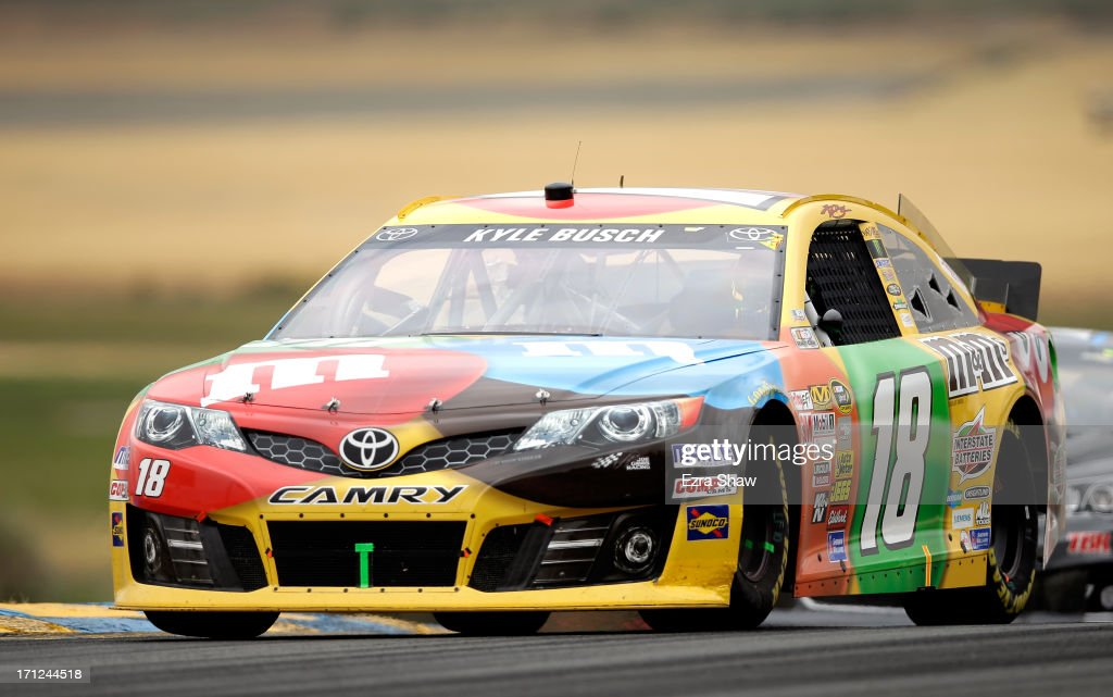 Kyle Busch, driver of the #18 M&M's Toyota, races during the NASCAR Sprint Cup Series Toyota/Save Mart 350 at Sonoma Raceway on June 23, 2013 in Sonoma, California.