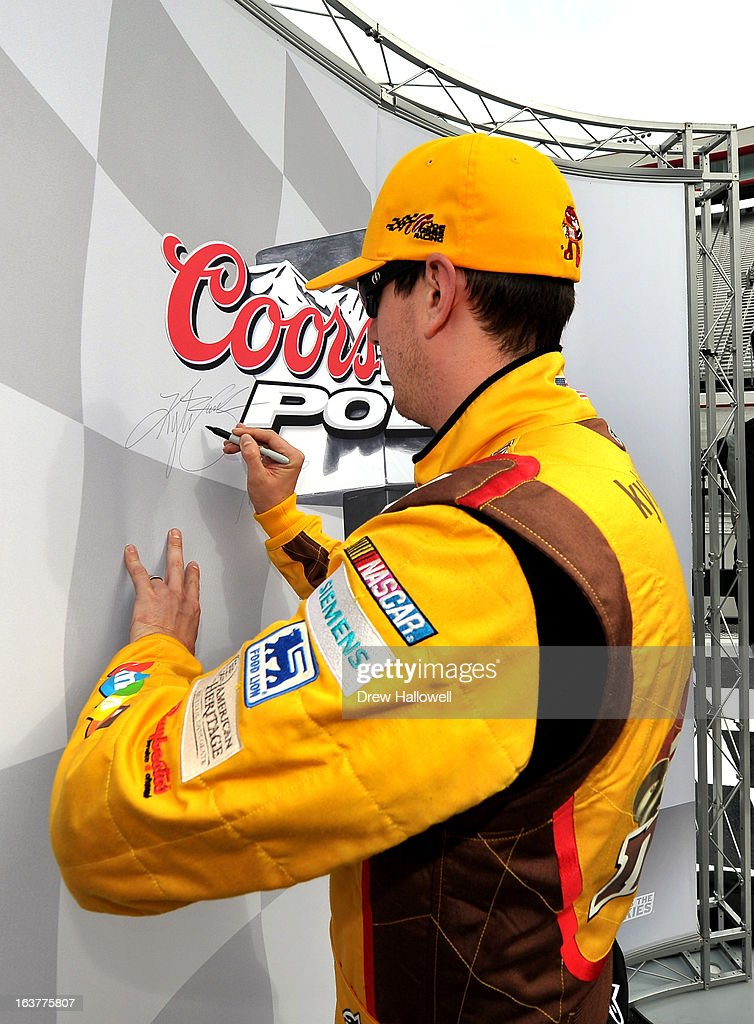 <a gi-track='captionPersonalityLinkClicked' href=/galleries/search?phrase=Kyle+Busch&family=editorial&specificpeople=211123 ng-click='$event.stopPropagation()'>Kyle Busch</a>, driver of the #18 M&M's Toyota, signs the wall in Victory Lane after qualifying for the pole position in the NASCAR Sprint Cup Series Food City 500 at Bristol Motor Speedway on March 15, 2013 in Bristol, Tennessee.
