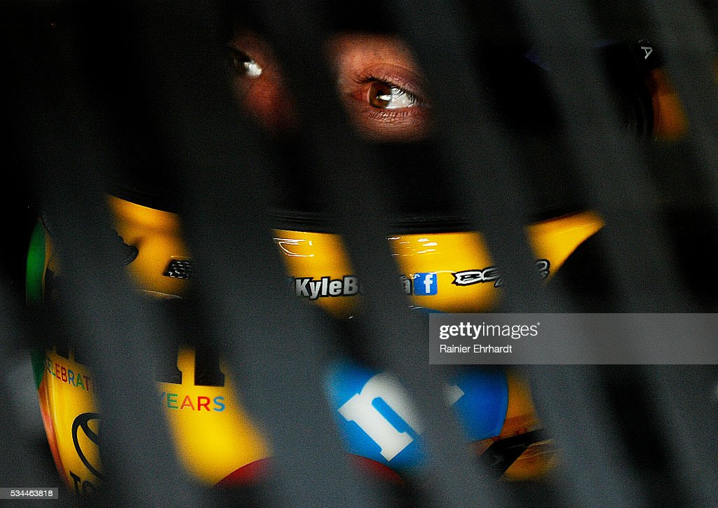 <a gi-track='captionPersonalityLinkClicked' href=/galleries/search?phrase=Kyle+Busch&family=editorial&specificpeople=211123 ng-click='$event.stopPropagation()'>Kyle Busch</a>, driver of the #18 M&M's Toyota, sits in his car during practice for the NASCAR Sprint Cup Series Coca-Cola 600 at Charlotte Motor Speedway on May 27, 2016 in Charlotte, North Carolina.