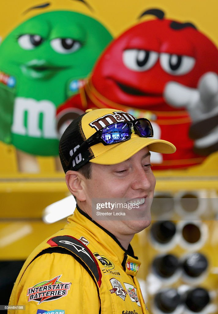 <a gi-track='captionPersonalityLinkClicked' href=/galleries/search?phrase=Kyle+Busch&family=editorial&specificpeople=211123 ng-click='$event.stopPropagation()'>Kyle Busch</a>, driver of the #18 M&M's Toyota, stands in the garage area during practice for the NASCAR Sprint Cup Series Coca-Cola 600 at Charlotte Motor Speedway on May 27, 2016 in Charlotte, North Carolina.