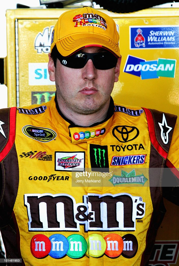 <a gi-track='captionPersonalityLinkClicked' href=/galleries/search?phrase=Kyle+Busch&family=editorial&specificpeople=211123 ng-click='$event.stopPropagation()'>Kyle Busch</a>, driver of the #18 M&M's Toyota, stands in the garage during practice for the NASCAR Sprint Cup Series Federated Auto Parts 400 at Richmond International Raceway on September 7, 2012 in Richmond, Virginia.