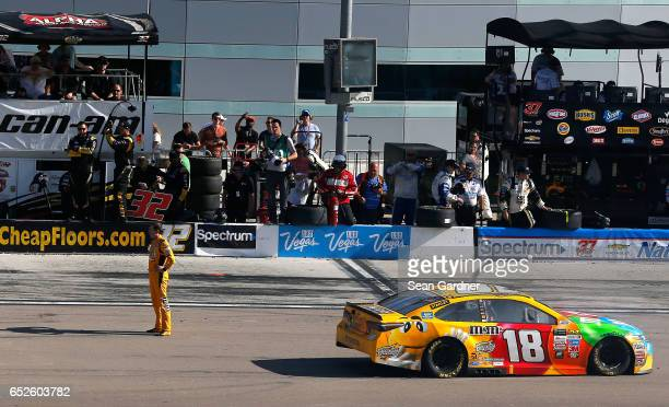 Kyle Busch driver of the MM's Toyota stands on pit road after the Monster Energy NASCAR Cup Series Kobalt 400 at Las Vegas Motor Speedway on March 12...
