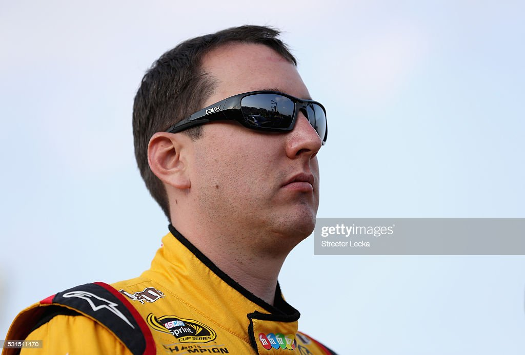 <a gi-track='captionPersonalityLinkClicked' href=/galleries/search?phrase=Kyle+Busch&family=editorial&specificpeople=211123 ng-click='$event.stopPropagation()'>Kyle Busch</a>, driver of the #18 M&M's Toyota, stands on the grid during qualifying for the NASCAR Sprint Cup Series Coca-Cola 600 at Charlotte Motor Speedway on May 27, 2016 in Charlotte, North Carolina.