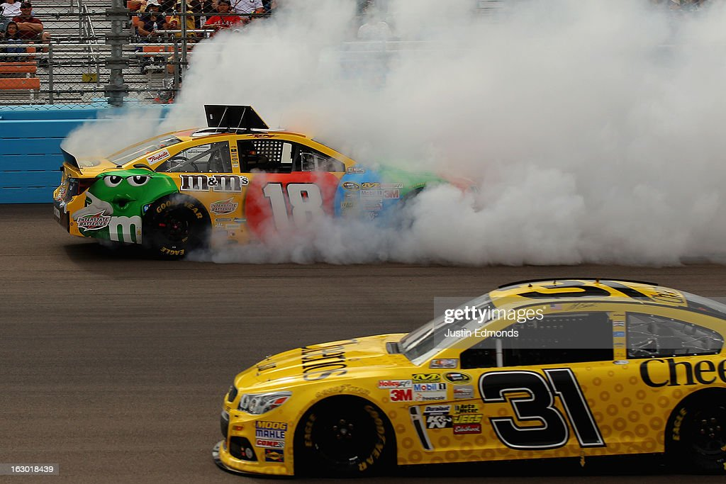 <a gi-track='captionPersonalityLinkClicked' href=/galleries/search?phrase=Kyle+Busch&family=editorial&specificpeople=211123 ng-click='$event.stopPropagation()'>Kyle Busch</a>, driver of the #18 M&M's Toyota, suffers damage after hitting the wall during the NASCAR Sprint Cup Series Subway Fresh Fit 500 at Phoenix International Raceway on March 3, 2013 in Avondale, Arizona.