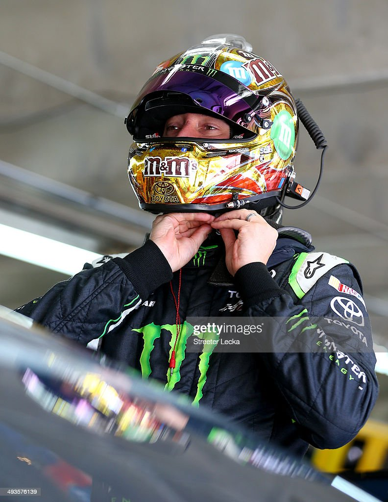 Kyle Busch, driver of the #18 M&M's Toyota, takes off his helmet during practice for the NASCAR Sprint Cup Series Coca-Cola 600 at Charlotte Motor Speedway on May 24, 2014 in Charlotte, North Carolina. Busch wore his Nationwide Series fire suit during Sprint Cup practice.