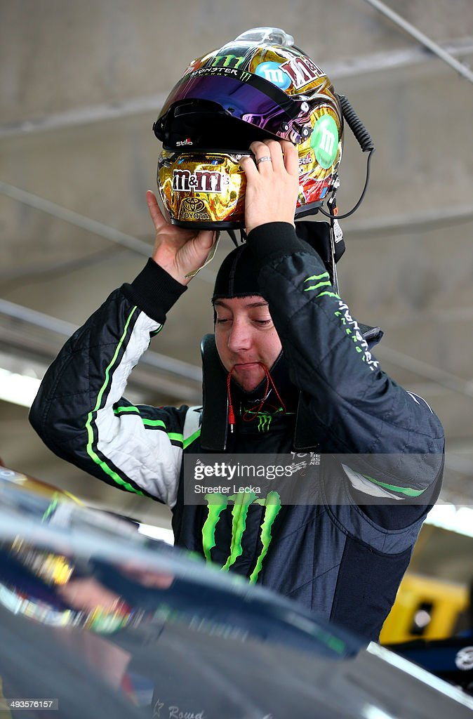 <a gi-track='captionPersonalityLinkClicked' href=/galleries/search?phrase=Kyle+Busch&family=editorial&specificpeople=211123 ng-click='$event.stopPropagation()'>Kyle Busch</a>, driver of the #18 M&M's Toyota, takes off his helmet during practice for the NASCAR Sprint Cup Series Coca-Cola 600 at Charlotte Motor Speedway on May 24, 2014 in Charlotte, North Carolina. Busch wore his Nationwide Series fire suit during Sprint Cup practice.