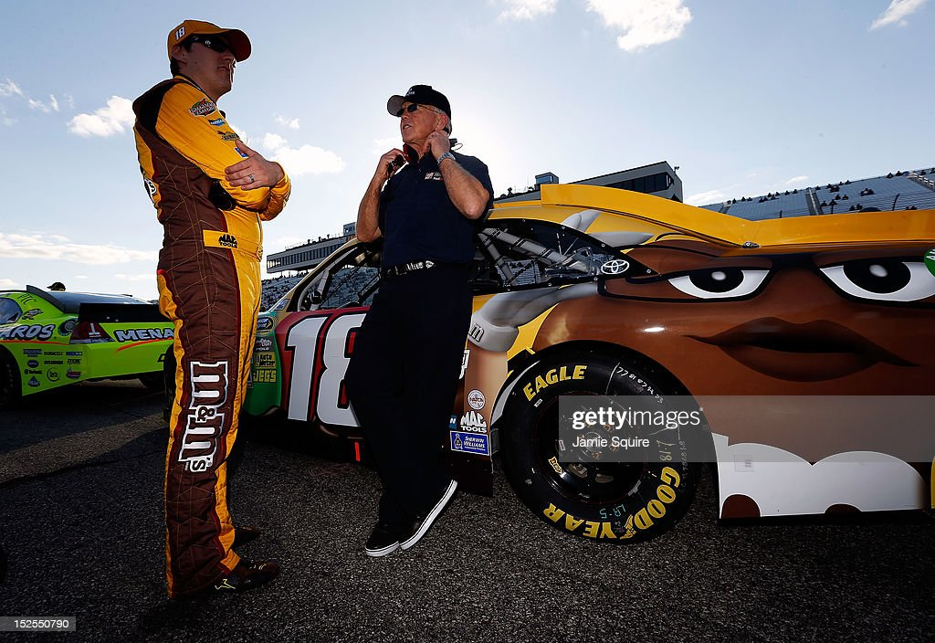 <a gi-track='captionPersonalityLinkClicked' href=/galleries/search?phrase=Kyle+Busch&family=editorial&specificpeople=211123 ng-click='$event.stopPropagation()'>Kyle Busch</a>, driver of the #18 M&M's Toyota, talks with team owner <a gi-track='captionPersonalityLinkClicked' href=/galleries/search?phrase=Joe+Gibbs&family=editorial&specificpeople=171526 ng-click='$event.stopPropagation()'>Joe Gibbs</a> during qualifying for the NASCAR Sprint Cup Series Sylvania 300 at New Hampshire Motor Speedway on September 21, 2012 in Loudon, New Hampshire.