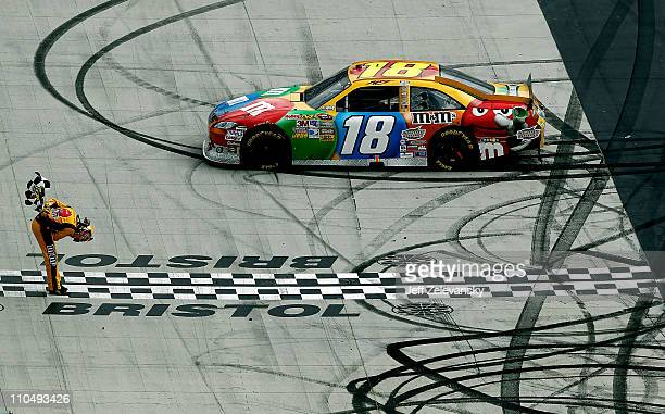 Kyle Busch driver of the MM'sToyota celebrates after winning the NASCAR Sprint Cup Series Jeff Byrd 500 Presented By Food City at Bristol Motor...