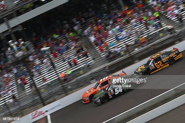 Kyle Busch driver of the Monster Energy Toyota and Daniel Suarez driver of the ARRIS Toyota take the green flag to start the NASCAR XFINITY Series...