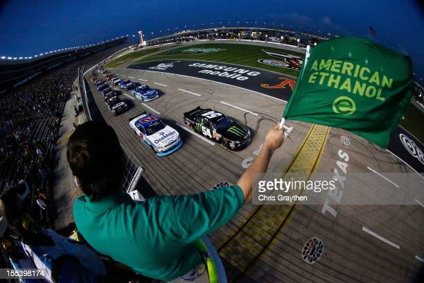 Kyle Busch driver of the Monster Energy Toyota and Elliott Sadler driver of the OneMain Financial Chevrolet lead the field to the green flag to start...