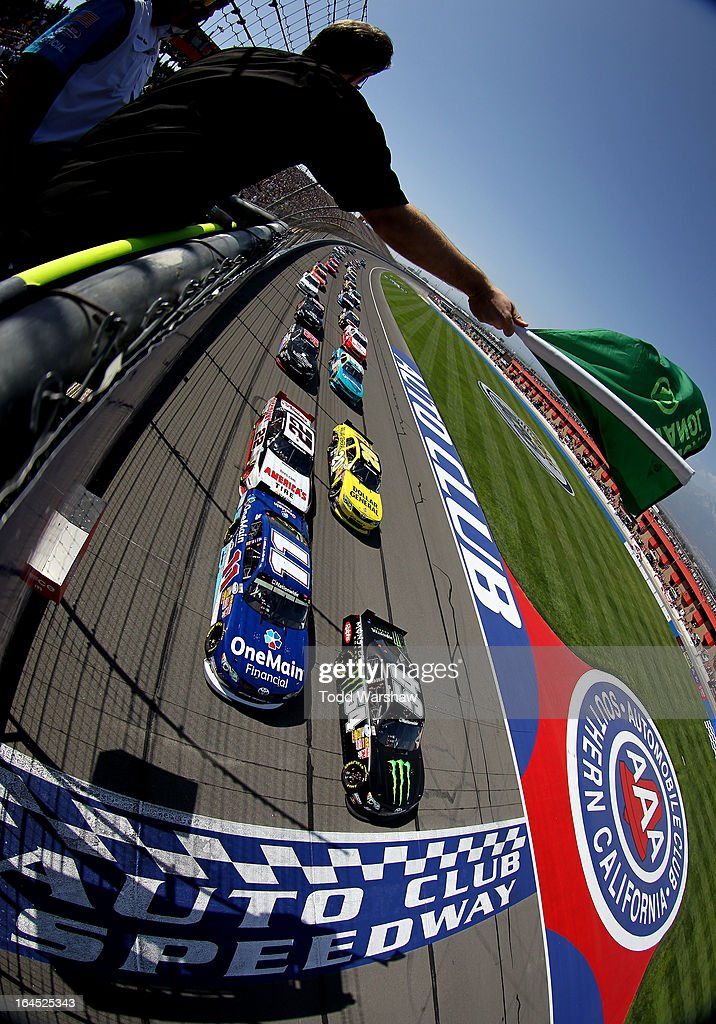 <a gi-track='captionPersonalityLinkClicked' href=/galleries/search?phrase=Kyle+Busch&family=editorial&specificpeople=211123 ng-click='$event.stopPropagation()'>Kyle Busch</a>, driver of the #54 Monster Energy Toyota, and <a gi-track='captionPersonalityLinkClicked' href=/galleries/search?phrase=Elliott+Sadler&family=editorial&specificpeople=204623 ng-click='$event.stopPropagation()'>Elliott Sadler</a>, driver of the #11 OneMain Financial Toyota, lead the field to the green flag to start the NASCAR Nationwide Series Royal Purple 300 at Auto Club Speedway on March 23, 2013 in Fontana, California.
