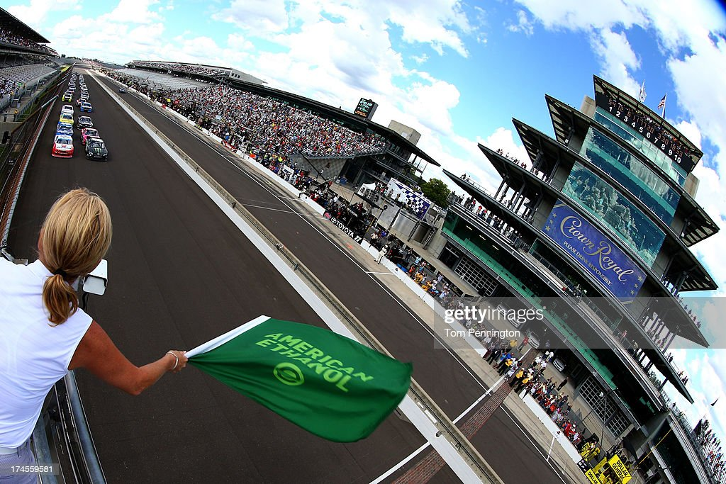Kyle Busch, driver of the #54 Monster Energy Toyota, and Sam Hornish Jr., driver of the #12 Wurth Ford, lead the field to the green flag to start the NASCAR Nationwide Series Indiana 250 at Indianapolis Motor Speedway on July 27, 2013 in Indianapolis, Indiana.