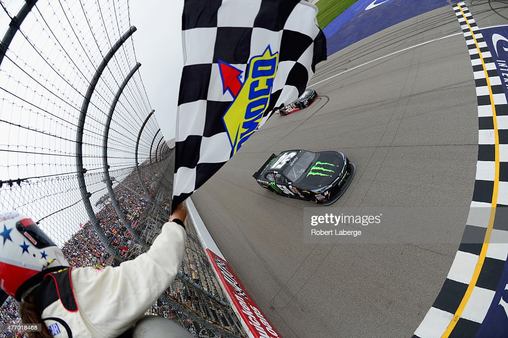 Kyle Busch driver of the Monster Energy Toyota approaches the finishline to win the NASCAR XFINITY Series Great Clips 250 Benefiting Paralyzed...