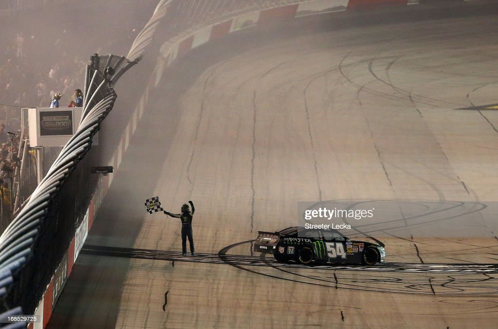 <a gi-track='captionPersonalityLinkClicked' href=/galleries/search?phrase=Kyle+Busch&family=editorial&specificpeople=211123 ng-click='$event.stopPropagation()'>Kyle Busch</a>, driver of the #54 Monster Energy Toyota, celebrates after performing a burnout following his win in the NASCAR Nationwide Series VFW Sport Clips Help A Hero 200 at Darlington Raceway on May 10, 2013 in Darlington, South Carolina.