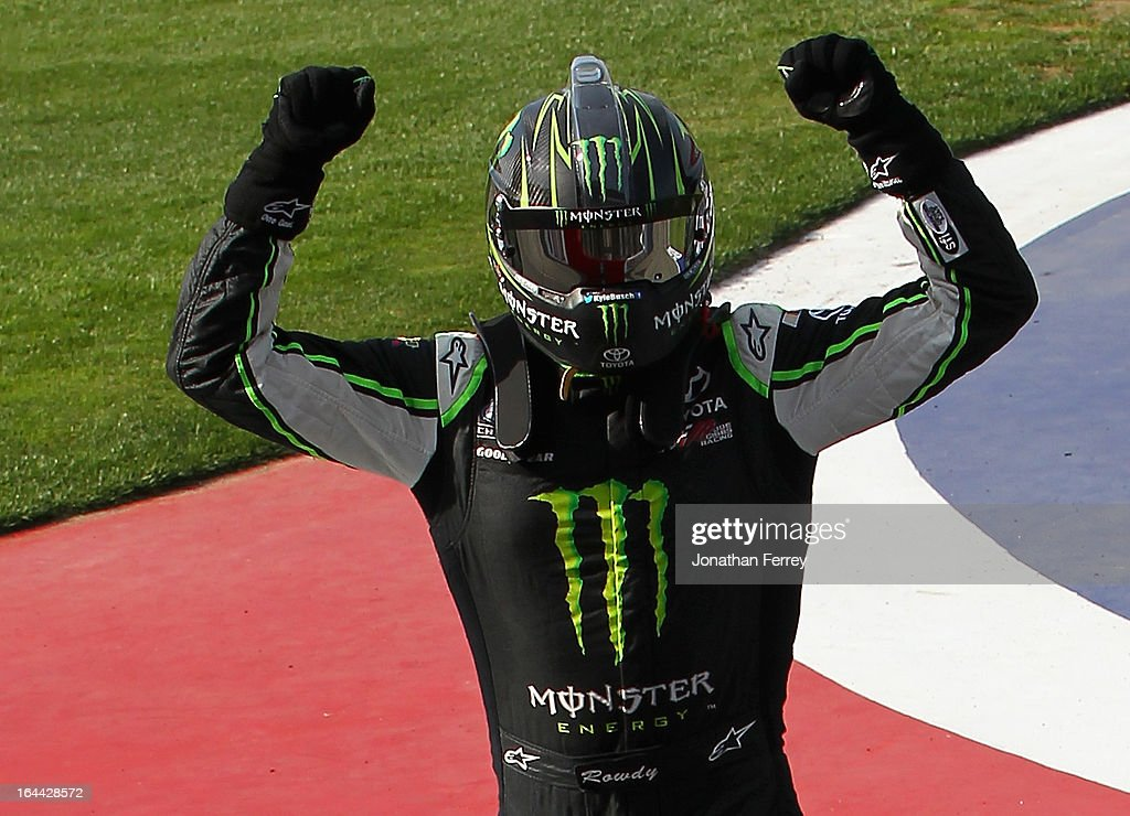 <a gi-track='captionPersonalityLinkClicked' href=/galleries/search?phrase=Kyle+Busch&family=editorial&specificpeople=211123 ng-click='$event.stopPropagation()'>Kyle Busch</a>, driver of the #54 Monster Energy Toyota, celebrates after winning the NASCAR Nationwide Series Royal Purple 300 at Auto Club Speedway on March 23, 2013 in Fontana, California.