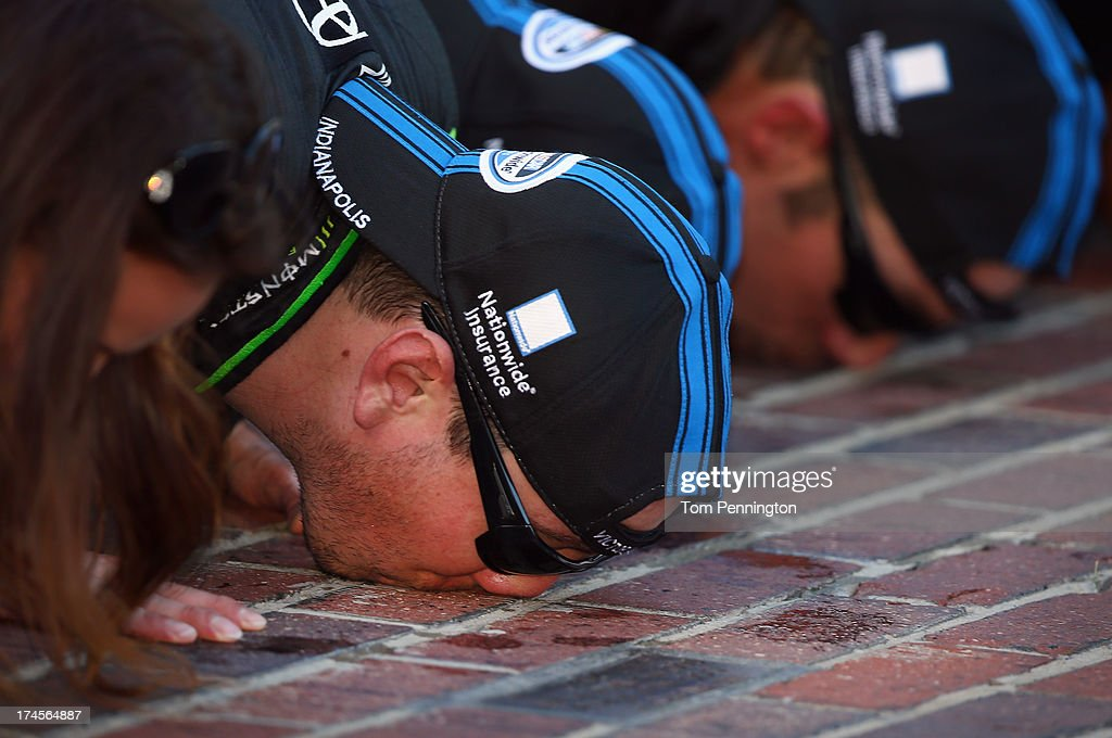 <a gi-track='captionPersonalityLinkClicked' href=/galleries/search?phrase=Kyle+Busch&family=editorial&specificpeople=211123 ng-click='$event.stopPropagation()'>Kyle Busch</a>, driver of the #54 Monster Energy Toyota, celebrates by kissing the bricks after winning the NASCAR Nationwide Series Indiana 250 at Indianapolis Motor Speedway on July 27, 2013 in Indianapolis, Indiana.