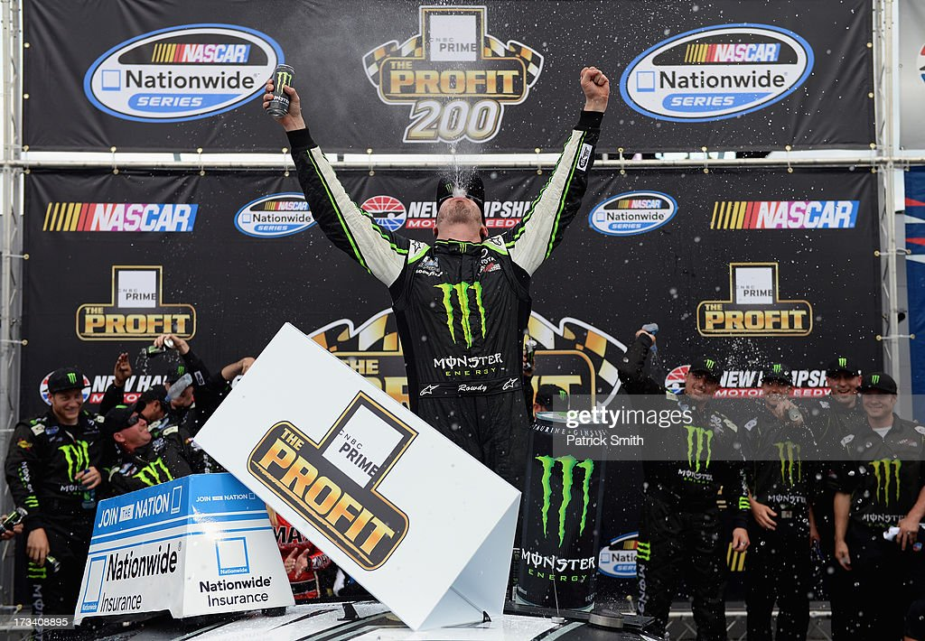 <a gi-track='captionPersonalityLinkClicked' href=/galleries/search?phrase=Kyle+Busch&family=editorial&specificpeople=211123 ng-click='$event.stopPropagation()'>Kyle Busch</a>, driver of the #54 Monster Energy Toyota, celebrates in Victory Lane after winning the NASCAR Nationwide Series CNBC Prime's The Profit 200 at New Hampshire Motor Speedway on July 13, 2013 in Loudon, New Hampshire.