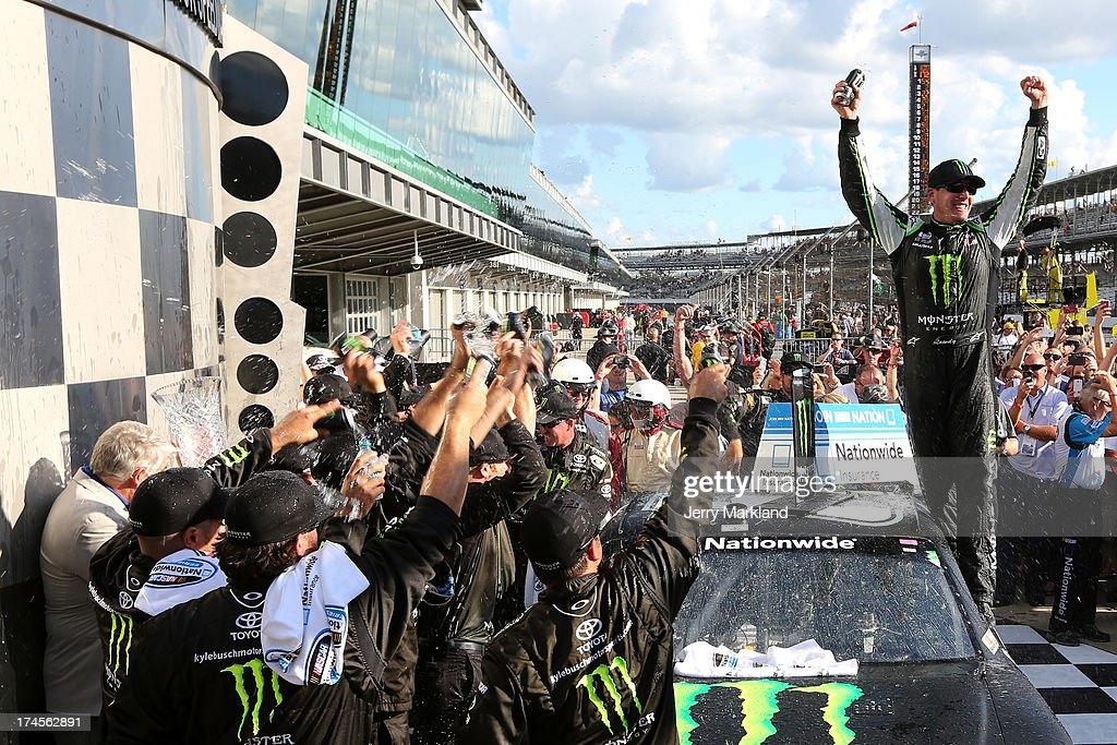 <a gi-track='captionPersonalityLinkClicked' href=/galleries/search?phrase=Kyle+Busch&family=editorial&specificpeople=211123 ng-click='$event.stopPropagation()'>Kyle Busch</a>, driver of the #54 Monster Energy Toyota, celebrates in victory lane after winning the NASCAR Nationwide Series Indiana 250 at Indianapolis Motor Speedway on July 27, 2013 in Indianapolis, Indiana.