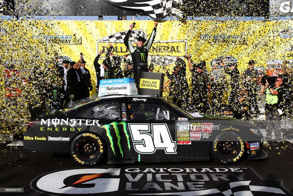<a gi-track='captionPersonalityLinkClicked' href=/galleries/search?phrase=Kyle+Busch&family=editorial&specificpeople=211123 ng-click='$event.stopPropagation()'>Kyle Busch</a>, driver of the #54 Monster Energy Toyota, celebrates in Victory Lane after winning the NASCAR Nationwide Series Dollar General 300 Powered by Coca-Cola at Chicagoland Speedway on September 14, 2013 in Joliet, Illinois.