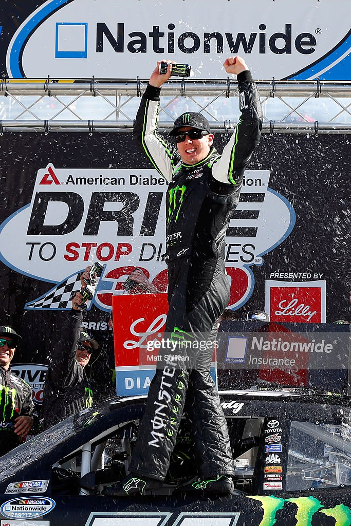 <a gi-track='captionPersonalityLinkClicked' href=/galleries/search?phrase=Kyle+Busch&family=editorial&specificpeople=211123 ng-click='$event.stopPropagation()'>Kyle Busch</a>, driver of the #54 Monster Energy Toyota, celebrates in Victory Lane after winning the NASCAR Nationwide Series Drive To Stop Diabetes 300 at Bristol Motor Speedway on March 15, 2014 in Bristol, Tennessee.