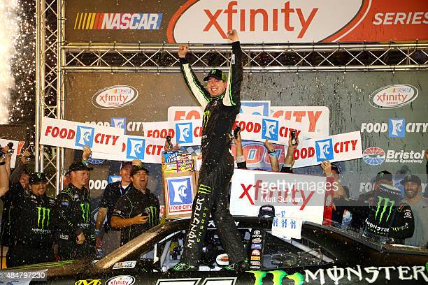 Kyle Busch driver of the Monster Energy Toyota celebrates in Victory Lane after winning the NASCAR XFINITY Series Food City 300 at Bristol Motor...