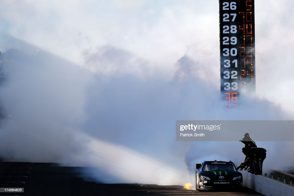 <a gi-track='captionPersonalityLinkClicked' href=/galleries/search?phrase=Kyle+Busch&family=editorial&specificpeople=211123 ng-click='$event.stopPropagation()'>Kyle Busch</a>, driver of the #54 Monster Energy Toyota, celebrates with a burnout after winning the NASCAR Nationwide Series Indiana 250 at Indianapolis Motor Speedway on July 27, 2013 in Indianapolis, Indiana.