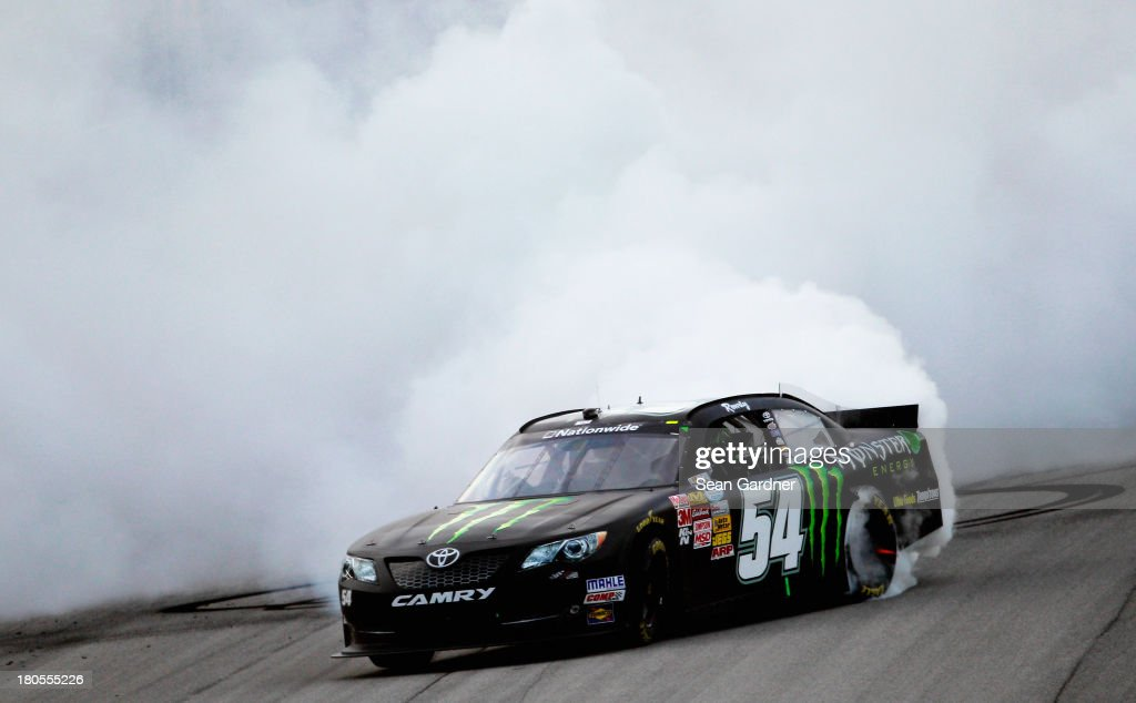 <a gi-track='captionPersonalityLinkClicked' href=/galleries/search?phrase=Kyle+Busch&family=editorial&specificpeople=211123 ng-click='$event.stopPropagation()'>Kyle Busch</a>, driver of the #54 Monster Energy Toyota, celebrates with a burnout after winning the NASCAR Nationwide Series Dollar General 300 Powered by Coca-Cola at Chicagoland Speedway on September 14, 2013 in Joliet, Illinois.
