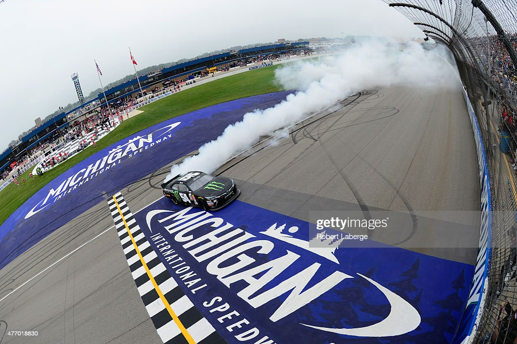 Kyle Busch driver of the Monster Energy Toyota celebrates with a burnout after winning the NASCAR XFINITY Series Great Clips 250 Benefiting Paralyzed...