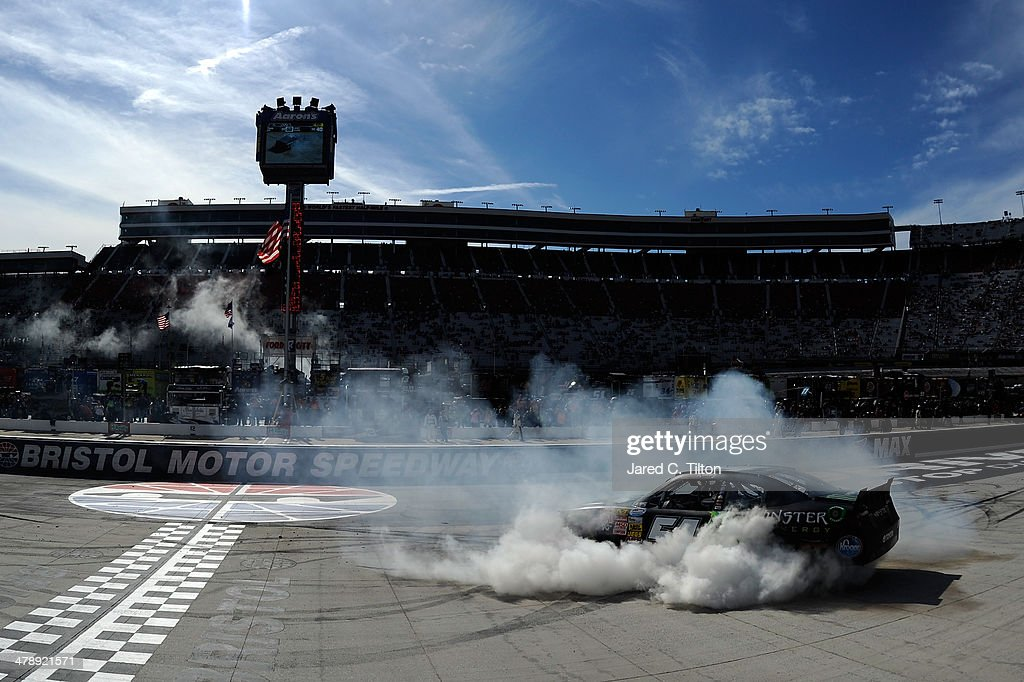 <a gi-track='captionPersonalityLinkClicked' href=/galleries/search?phrase=Kyle+Busch&family=editorial&specificpeople=211123 ng-click='$event.stopPropagation()'>Kyle Busch</a>, driver of the #54 Monster Energy Toyota, celebrates with a burnout after winning the NASCAR Nationwide Series Drive To Stop Diabetes 300 at Bristol Motor Speedway on March 15, 2014 in Bristol, Tennessee.
