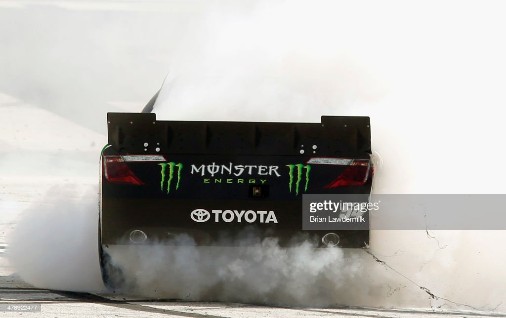 Kyle Busch, driver of the #54 Monster Energy Toyota, celebrates with a burnout after winning the NASCAR Nationwide Series Drive To Stop Diabetes 300 at Bristol Motor Speedway on March 15, 2014 in Bristol, Tennessee.