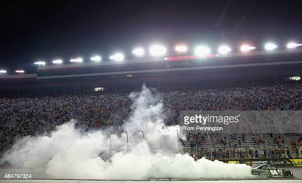 Kyle Busch driver of the Monster Energy Toyota celebrates with a burnout after winning the NASCAR XFINITY Series Food City 300 at Bristol Motor...
