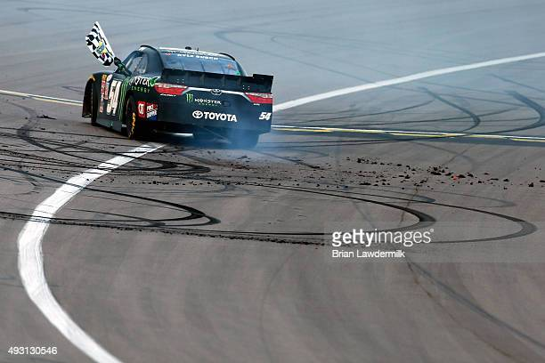 Kyle Busch driver of the Monster Energy Toyota celebrates with a burnout after winning the NASCAR XFINITY Series Kansas Lottery 300 at Kansas...