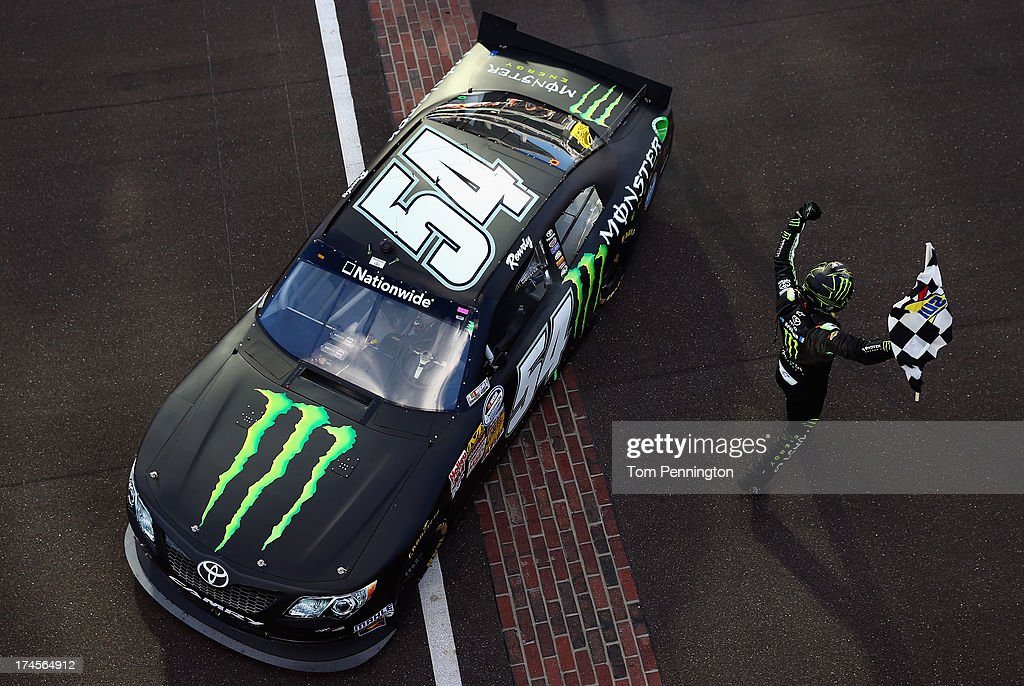 <a gi-track='captionPersonalityLinkClicked' href=/galleries/search?phrase=Kyle+Busch&family=editorial&specificpeople=211123 ng-click='$event.stopPropagation()'>Kyle Busch</a>, driver of the #54 Monster Energy Toyota, celebrates with the checkered flag after winning the NASCAR Nationwide Series Indiana 250 at Indianapolis Motor Speedway on July 27, 2013 in Indianapolis, Indiana.