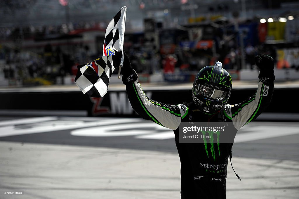 <a gi-track='captionPersonalityLinkClicked' href=/galleries/search?phrase=Kyle+Busch&family=editorial&specificpeople=211123 ng-click='$event.stopPropagation()'>Kyle Busch</a>, driver of the #54 Monster Energy Toyota, celebrates with the checkered flag after winning the NASCAR Nationwide Series Drive To Stop Diabetes 300 at Bristol Motor Speedway on March 15, 2014 in Bristol, Tennessee.