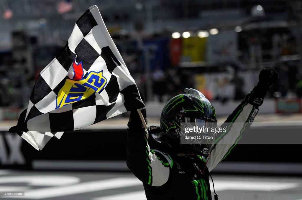 Kyle Busch, driver of the #54 Monster Energy Toyota, celebrates with the checkered flag after winning the NASCAR Nationwide Series Drive To Stop Diabetes 300 at Bristol Motor Speedway on March 15, 2014 in Bristol, Tennessee.