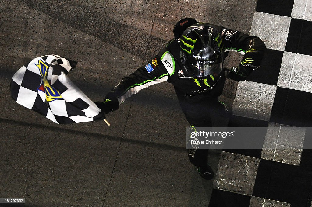 Kyle Busch driver of the Monster Energy Toyota celebrates with the checkered flag after winning the NASCAR XFINITY Series Food City 300 at Bristol...