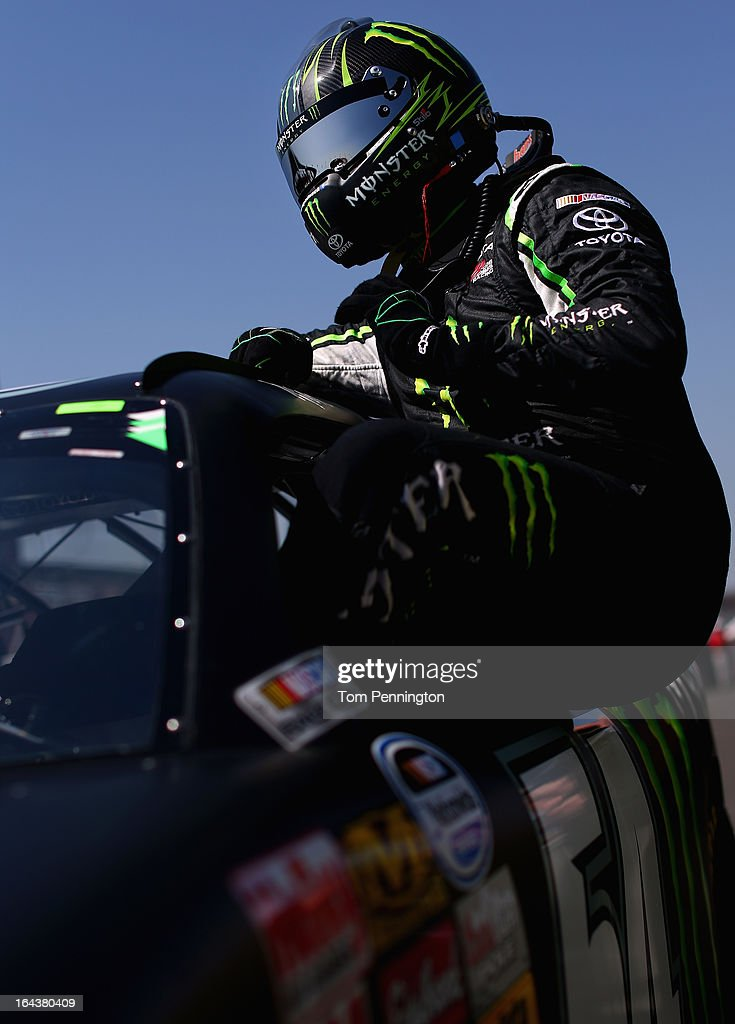 Kyle Busch, driver of the #54 Monster Energy Toyota, climbs out his car after qualifying for the NASCAR Nationwide Series Royal Purple 300 at Auto Club Speedway on March 23, 2013 in Fontana, California.