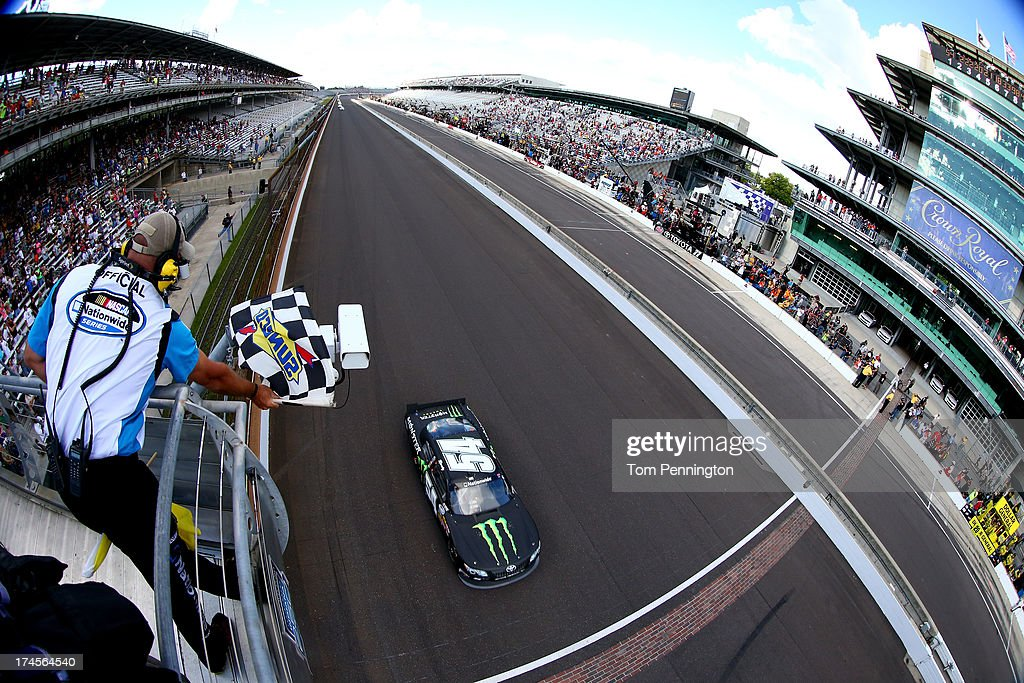 <a gi-track='captionPersonalityLinkClicked' href=/galleries/search?phrase=Kyle+Busch&family=editorial&specificpeople=211123 ng-click='$event.stopPropagation()'>Kyle Busch</a>, driver of the #54 Monster Energy Toyota, crosses the finish line to win the NASCAR Nationwide Series Indiana 250 at Indianapolis Motor Speedway on July 27, 2013 in Indianapolis, Indiana.