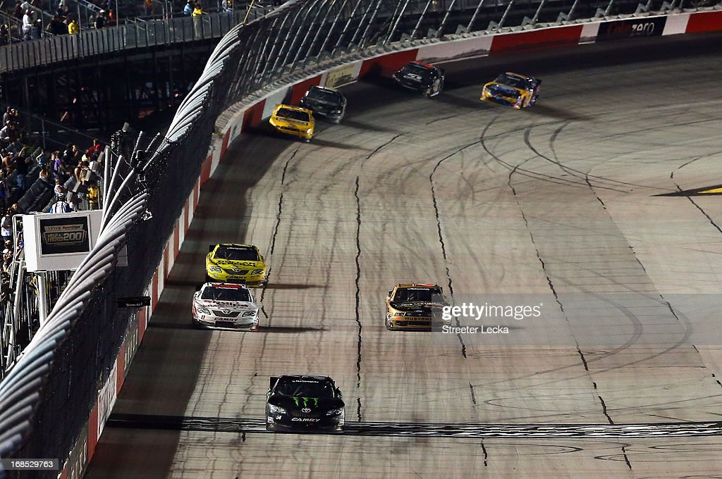 Kyle Busch, driver of the #54 Monster Energy Toyota, crosses the star/finish line to take the checkered flag and win the NASCAR Nationwide Series VFW Sport Clips Help A Hero 200 at Darlington Raceway on May 10, 2013 in Darlington, South Carolina.