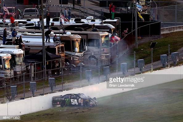 Kyle Busch driver of the Monster energy Toyota is seen stopped against a wall after crashing during the NASCAR XFINITY Series Alert Today Florida 300...